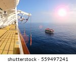 cruise ship and tender boat on... | Shutterstock . vector #559497241