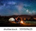 male hiker shows his lover in... | Shutterstock . vector #559509625