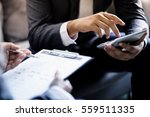 business partners discussing... | Shutterstock . vector #559511335