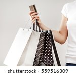 Woman Holding Shopping Bags An...