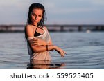 girl on the beach in the... | Shutterstock . vector #559525405