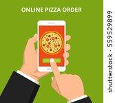 online order pizza. hand... | Shutterstock .eps vector #559529899