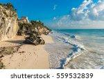 White Sand Beach And Ruins Of...