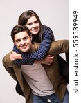handsome man giving piggy back... | Shutterstock . vector #559539949