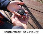 buyer's hand taking a car key. | Shutterstock . vector #559546279