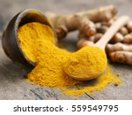 turmeric powder and fresh... | Shutterstock . vector #559549795
