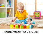 child boy playing toy blocks... | Shutterstock . vector #559579801