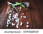 Small photo of glasses with airsoft balls
