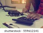 man using calculator calculate... | Shutterstock . vector #559612141