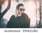 trendy young woman posing... | Shutterstock . vector #559621381