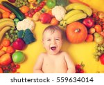 baby surrounded with fruits and ... | Shutterstock . vector #559634014