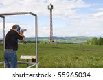 a man shoots a gun on skeet | Shutterstock . vector #55965034