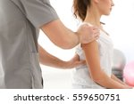 physiotherapist working with... | Shutterstock . vector #559650751