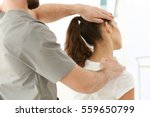 physiotherapist working with... | Shutterstock . vector #559650799