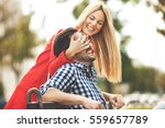 young happy couple is enjoying... | Shutterstock . vector #559657789