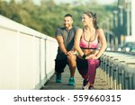 happy couple exercising... | Shutterstock . vector #559660315