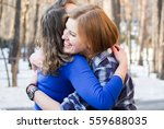 Two Beautiful Girl Friends Hug...