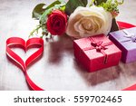 roses and a hearts on board ... | Shutterstock . vector #559702465