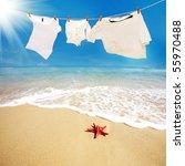 Stock photo t shirt with red starfish on beach 55970488