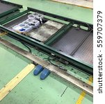 Small photo of The production line transfer skid and skid rail.