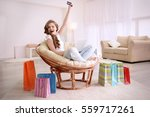 young woman shopping online... | Shutterstock . vector #559717261
