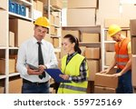 two business people at warehouse | Shutterstock . vector #559725169