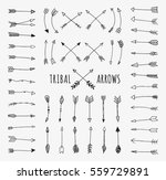 Hand drawn arrows set. Doodle tribal vectors isolated on off-white background.