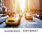 Yellow Taxi In A Black And...