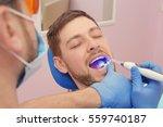 dentist examining patient's... | Shutterstock . vector #559740187