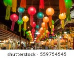 hanging colorful paper lanterns ... | Shutterstock . vector #559754545