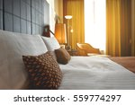 Stock photo luxury bedrooms with flare light 559774297