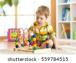 little kid boy plays with a... | Shutterstock . vector #559784515