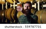 expert brewer of beer tastes... | Shutterstock . vector #559787731