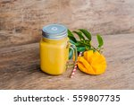 juicy smoothie from mango in... | Shutterstock . vector #559807735