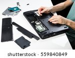 repairing old laptop pc. person ... | Shutterstock . vector #559840849
