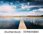 Old Wooden Boards Pier On Calm...