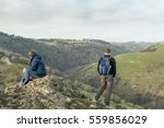 Two Hikers Take In The View At...