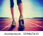 an athletic pair of legs going... | Shutterstock . vector #559867615