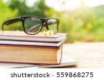 Old Book And Eye Glasses For...