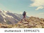 Hiker Going Along Green Hills...