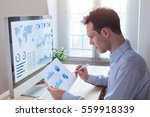 investor analyzing financial... | Shutterstock . vector #559918339