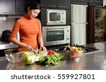 Woman Cutting Vegetables In...