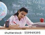 teacher working at desk | Shutterstock . vector #559949395
