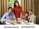 woman stands over dinner table... | Shutterstock . vector #559949707