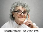 grandmother with glasses points ... | Shutterstock . vector #559954195