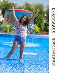 girl in pool   Shutterstock . vector #559955971
