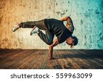 young man break dancing on wall ... | Shutterstock . vector #559963099