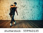 young man break dancing on wall ... | Shutterstock . vector #559963135