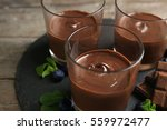 chocolate mousse in glasses on... | Shutterstock . vector #559972477