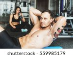 a guy and a girl in the gym... | Shutterstock . vector #559985179